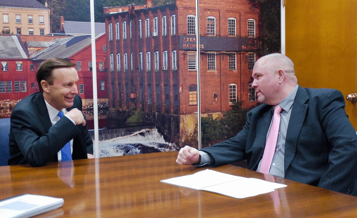 AFSCME member Shawn Dougherty talks to Sen. Chris Murphy of Connecticut